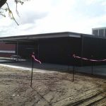 Outside View Of A Burgundy Coloured Modern Commercial Factory Building - Australian Building Maintenance Company