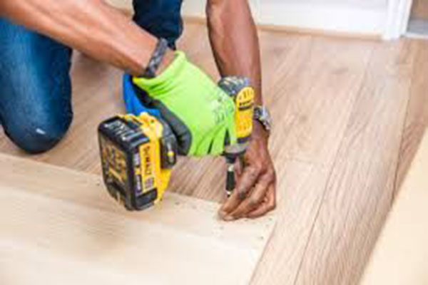 Tradesman Installing A Floor - Carpentry - Australian Building Maintenance Company